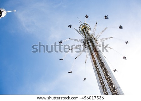 A look from below on the tower raising up in the blue sky - stock photo