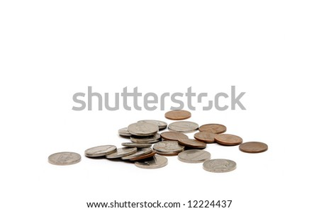 A loose pile of vintage American coins of various denominations. Old coins are becoming increasingly valuable due to their high content of silver and copper. - stock photo