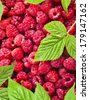 A lot of a tasty juicy raspberry heap pile surface top view - stock photo