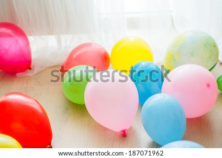 A lot of balloons on the floor - stock photo