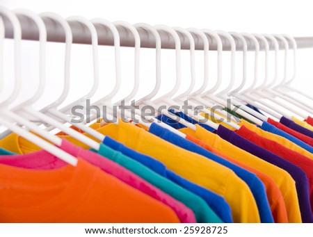 A lot of bright colored Tee Shirts hanging - stock photo