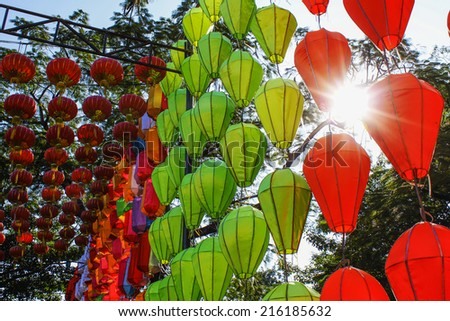 A lot of chinese laterns hanging sunlingting in sky - stock photo