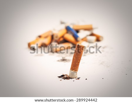 A lot of cigarette butts. Anti-smoking background