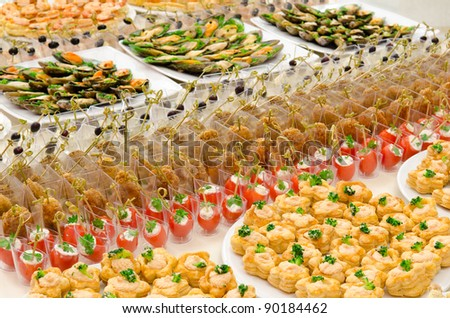 a lot of cold snacks on buffet table, catering - stock photo