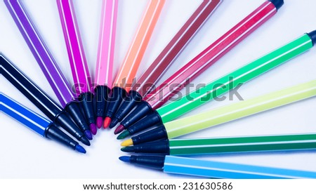 a lot of color pen on table - stock photo