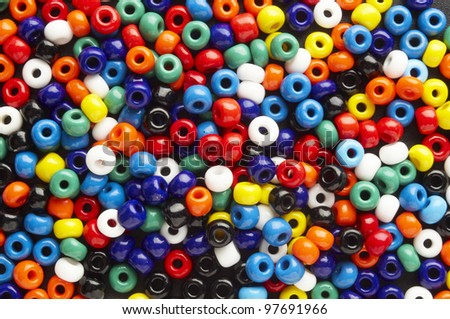a  lot of colorful beads on plane