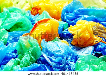 A lot of colorful disposable rubbish bags - stock photo