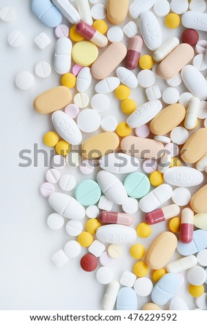 A lot of colorful medication  on background white
