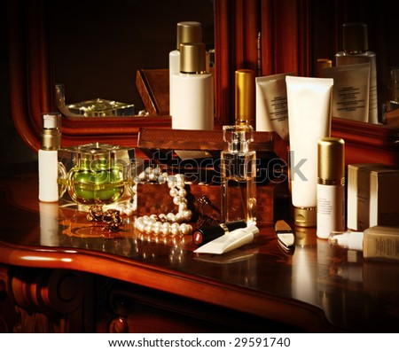 a lot of cosmetics bottles on a table - stock photo