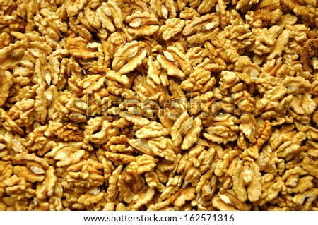 a lot of cracked walnuts, background, isolated - stock photo