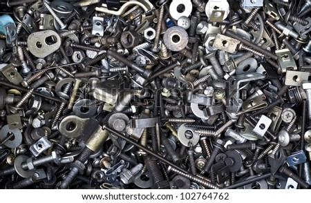 a lot of different auto spare parts, steel background - stock photo