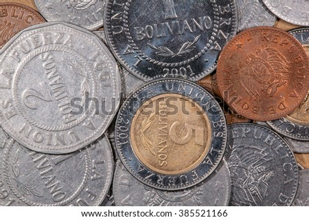 A lot of different colored world coins - stock photo
