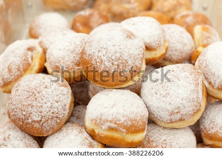 a lot of donuts on the counter in a supermarket - stock photo