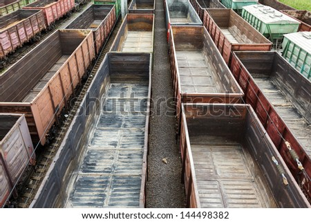 a lot of empty wagons for bulk materials - stock photo