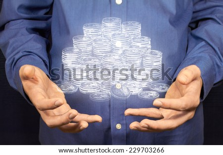 A lot of Euro coins floating above two hands. - stock photo