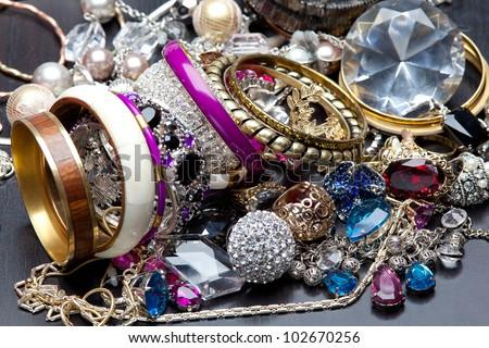 A lot of fashionable women's jewelry, brilliant bangles - stock photo