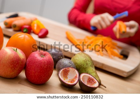 a lot of fresh organic food and a pregnant woman at the background - stock photo