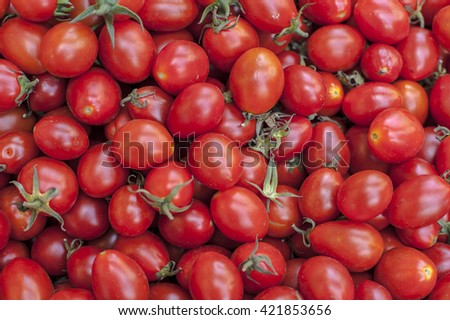 A lot of fresh red tomato together. - stock photo