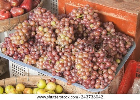 A lot of fresh, violet grapes, at a market