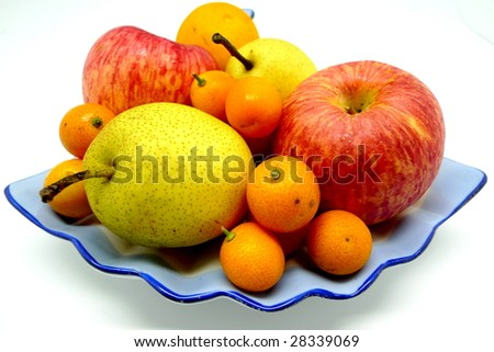 A lot of fruit on a fan shape plate with white background. - stock photo