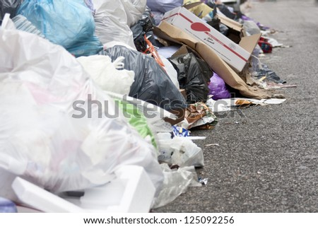 a lot of garbage in the street  with wall and waste - stock photo