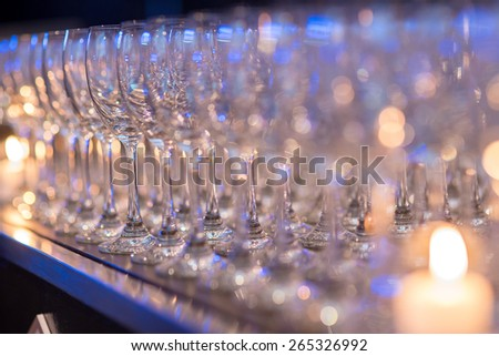 A lot of Glasses in a row on bar - stock photo