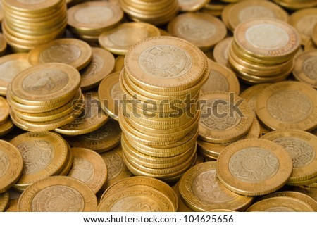 a lot of golden coins, mexican ten pesos coins - stock photo
