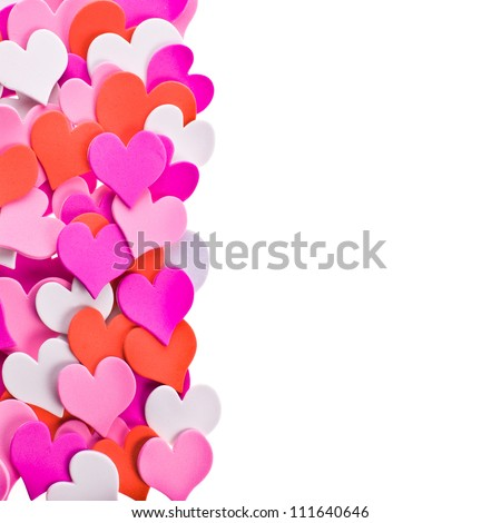 a lot of hearts in different colors. laid out in the form of ornament as a border. isolated on white background - stock photo