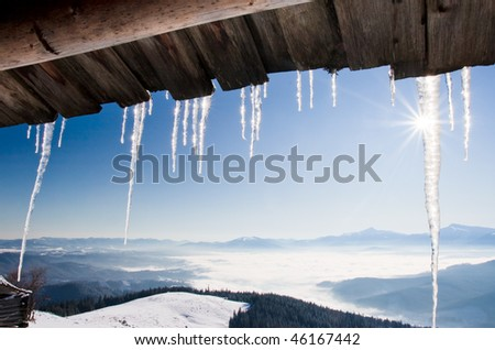 A lot of icicles over blue sky - stock photo