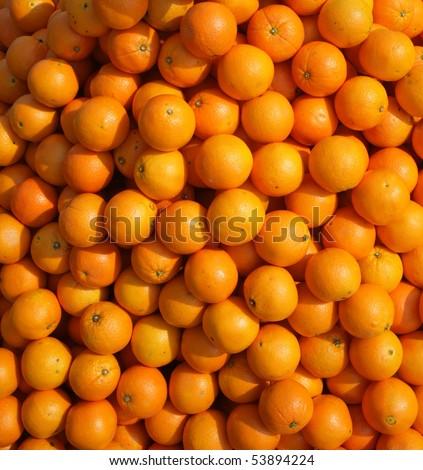 a lot of juicy, ripe oranges closeup - stock photo