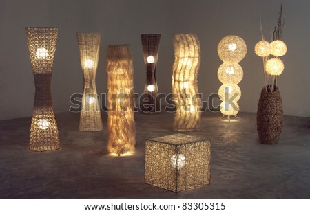 A lot of lighten floor  lamps which made of rattan, bamboo and dried water hyacinth in the dark room - stock photo
