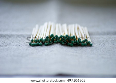 A lot of matches on the wooden background