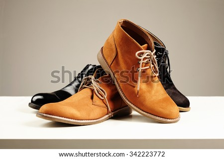 a lot of men's shoes.fashion still life men boots. - stock photo