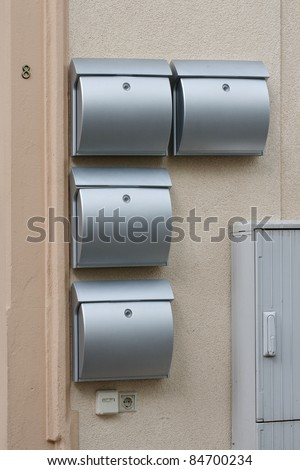A lot of metal mailboxes on the wall of an apartment house - stock photo