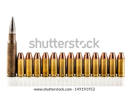 a lot of 9mm bullets arranged in a row and isolated over a white background - stock photo
