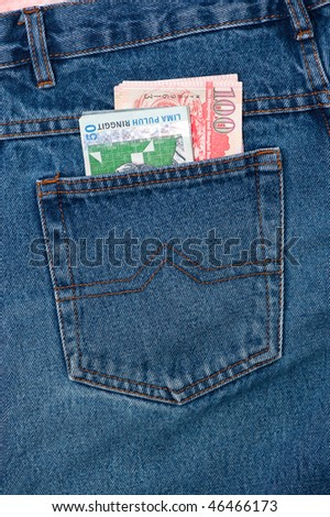 a lot of money in a denim pocket - stock photo