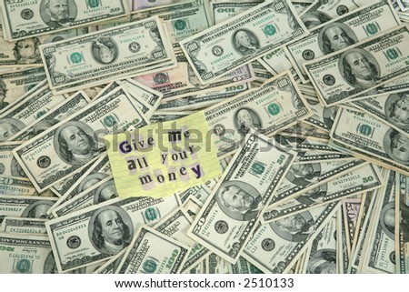 "A lot of money with a bank robber note that say ""give me all your money"" - stock photo"