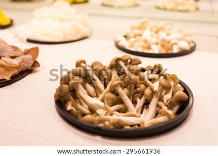 A lot of mushroom,which is ingredient, in pot - stock photo