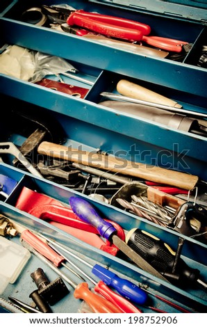 a lot of old instruments in tool box - stock photo