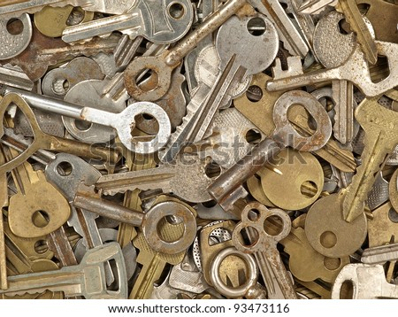 A lot of old metal keys taken closeup as background. - stock photo