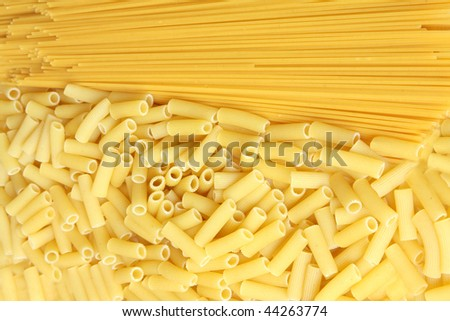 A lot of pasta. Background made from spaghetti and penne