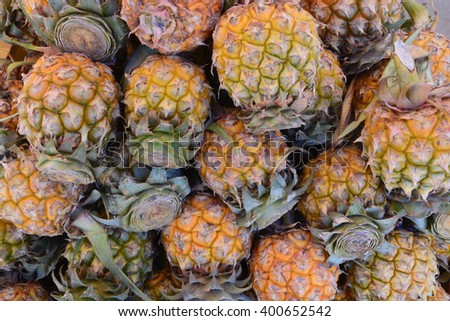 A lot of pineapple fruit background - stock photo