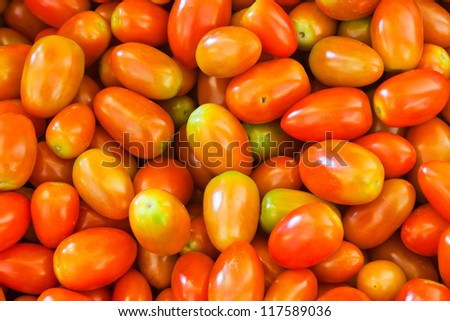 a lot of ripe tomatoes background