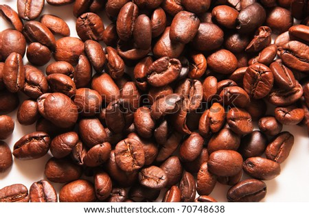 A lot of roasted coffee beans on white background