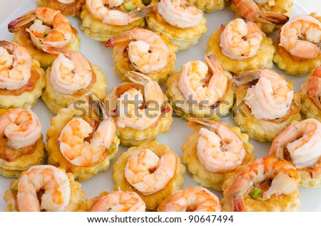 a lot of shrimp snacks on buffet table, catering - stock photo