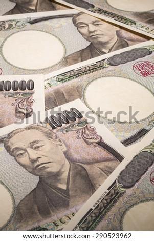 A lot of ten thousand yen bill - stock photo