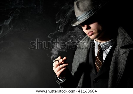 A lot of tobacco smoke exhaled by man in a stylish retro costume - stock photo
