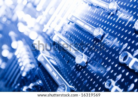 a lot of tools on mirroring steel panel - stock photo