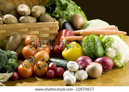 A lot of vegetables on wooden table - stock photo
