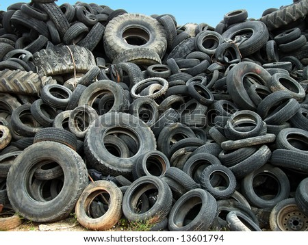 A lot of Wheel Tires dumped in a landfill - stock photo